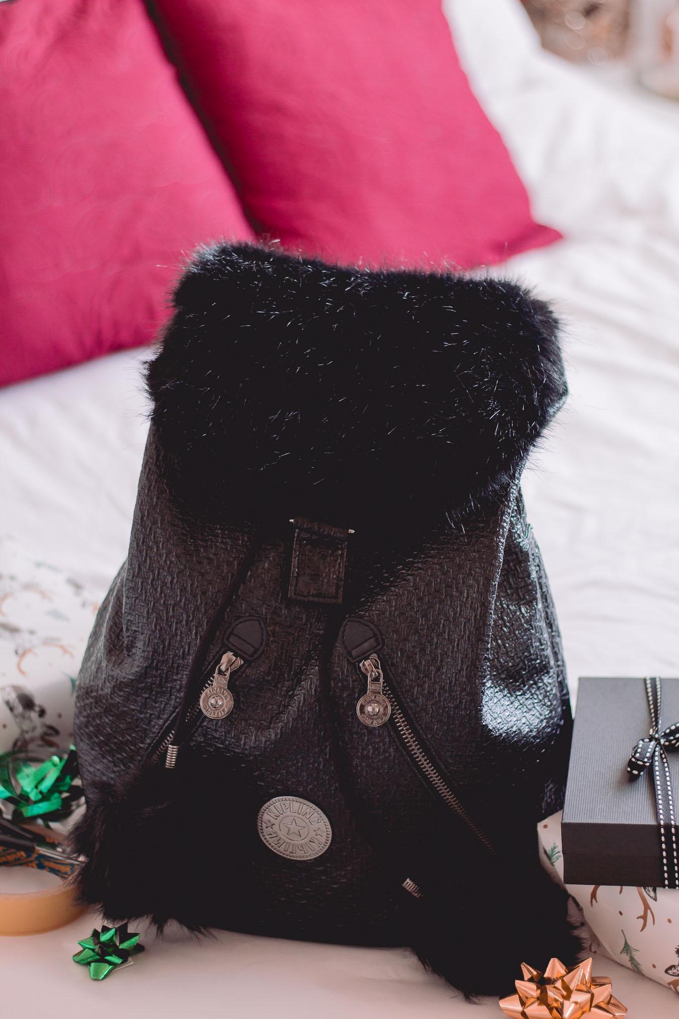 up close shot of kipling bag amongst gifts