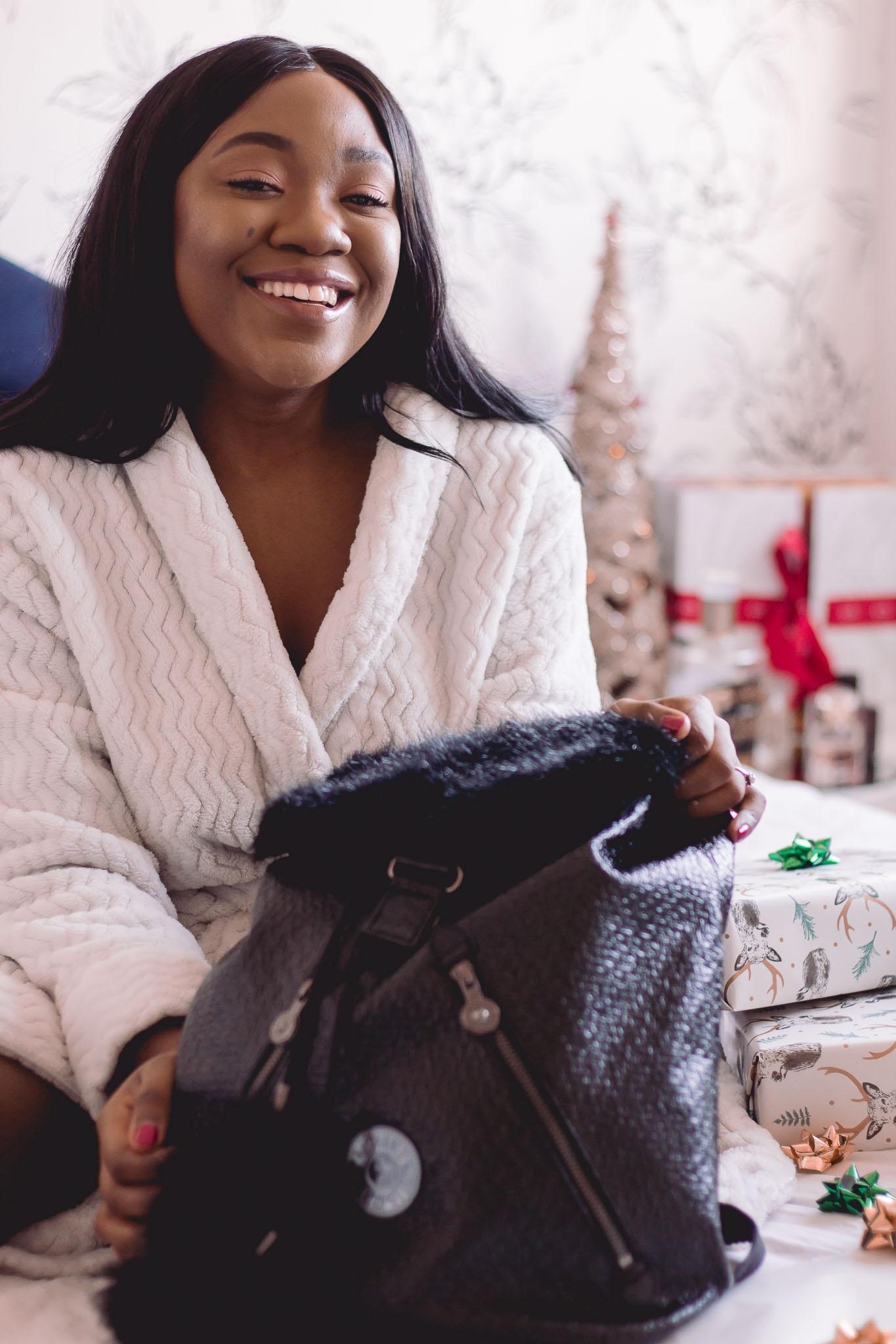 girl happy with kipling gift