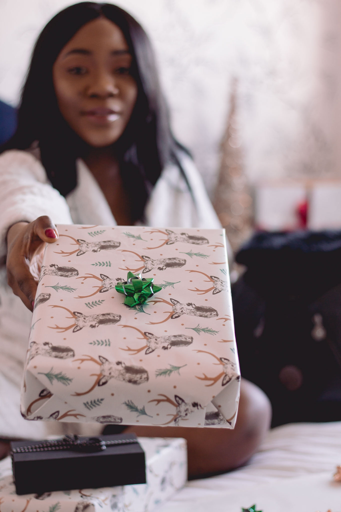 girl gifting present to someone